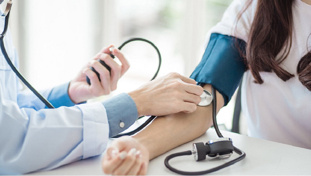 A woman's blood pressure is checked